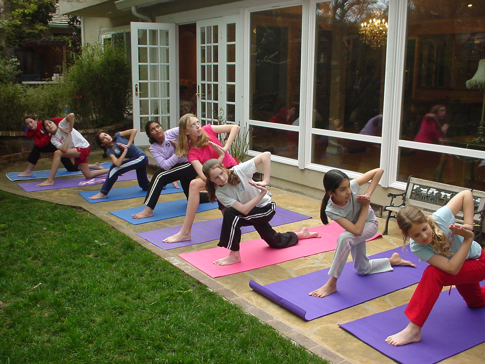 Preteen Girls in Sun Salutation